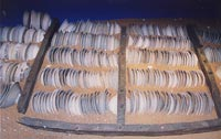 Plates from the 'Royal Nanhai', c.1460, stacked between replica bulkheads at Muzium Negara.